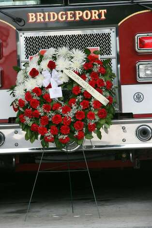 Bridgeport Ocean Terrace firehouse mourns the death of two firefighters, Lt. Steven Velasquez and Michel Baik, who died fighting a fire on Elmwood Ave. on Saturday. Photo: B.K. Angeletti / Connecticut Post