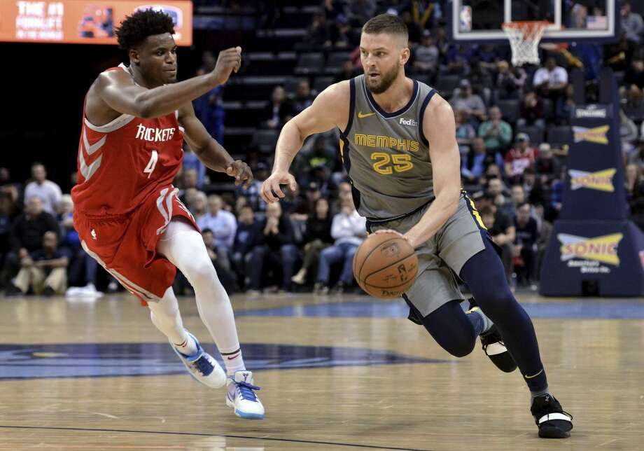 Memphis Grizzlies forward Chandler Parsons (25) drives against Houston Rockets forward Danuel House Jr. (4) in overtime of an NBA basketball game Wednesday, March 20, 2019, in Memphis, Tenn. (AP Photo/Brandon Dill) Photo: Brandon Dill/Associated Press