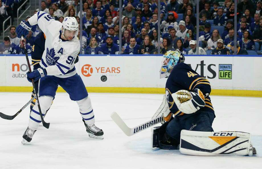 Buffalo Sabres goalie Carter Hutton (40) stops Toronto Maple Leafs forward John Tavares (91) during the first period of an NHL hockey game Wednesday, March 20, 2019, in Buffalo, N.Y. (AP Photo/Jeffrey T. Barnes) Photo: Jeffrey T. Barnes / Copyright 2019. The Associated Press. All Rights Reserved.