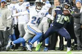 Seahawks wide receiver Paul Richardson makes a one-handed catch while being guarded by Lions corner back Nevin Lawson during the second half of a wild card playoff game at CenturyLink Field on Saturday, Jan. 7, 2017. (GRANT HINDSLEY, seattlepi.com)