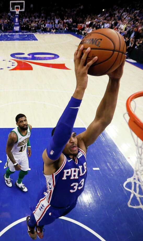Philadelphia 76ers' Tobias Harris dunks as Boston Celtics' Kyrie Irving watches during the second half of an NBA basketball game Wednesday, March 20, 2019, in Philadelphia. Philadelphia won 118-115. (AP Photo/Matt Slocum) Photo: Matt Slocum / Copyright 2019 The Associated Press. All rights reserved