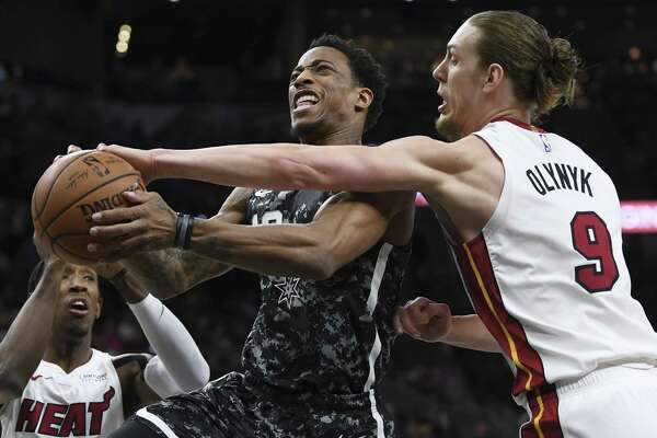 DeMar DeRozan of the San Antonio Spurs drives as Kelly Olynyk of the Miami Heat defends during NBA action in the AT&T Center on Wednesday, March 20, 2019.
