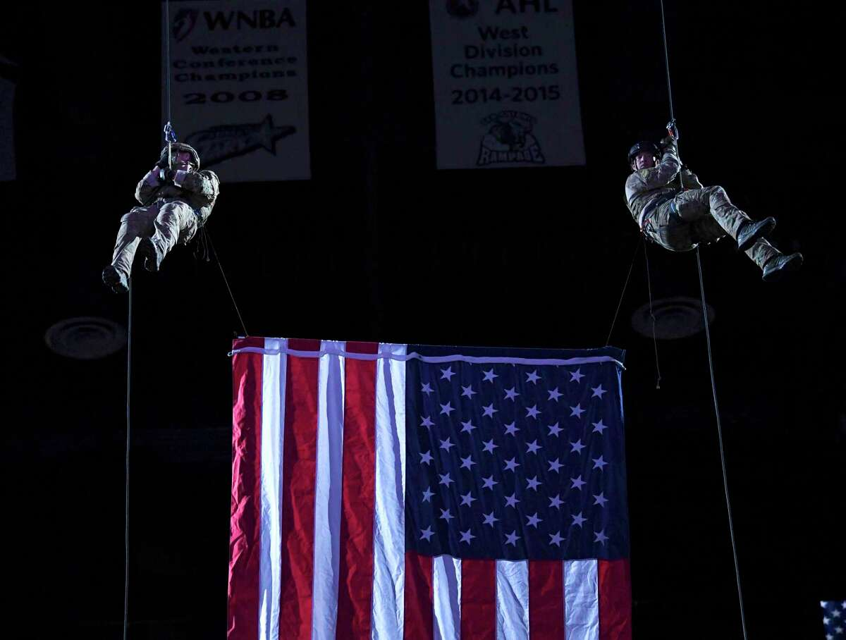 Army troopers rappel during a night to honor active duty military and veterans before the San Antonio Spurs hosted the Miami Heat in the AT&T Center last March. A series of Veterans Day events are planned this weekend and Monday.