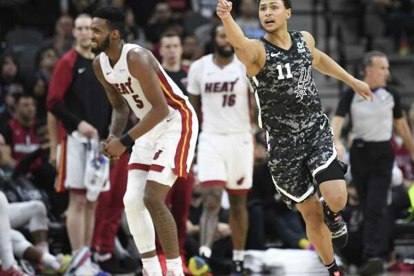 San Antonio Spurs guard Bryn Forbes (11) gestures after scoring on a three-point shot during the team's 110-105 loss to the Miami Heat in the AT&T Center on Wednesday, March 20, 2019.