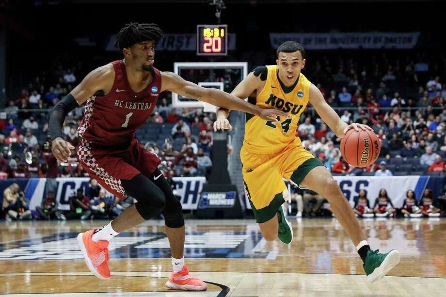 North Dakota State's Tyson Ward (24) drives against North Carolina Central's Zacarry Douglas (1) during the second half of a First Four game of the NCAA men's college basketball tournament Wednesday, March 20, 2019, in Dayton, Ohio. (AP Photo/John Minchillo) Photo: John Minchillo / Copyright 2019 The Associated Press. All rights reserved.