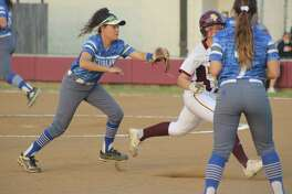 Deer Park's Jayse Roberts is about to become an out on the basepaths during third-inning action Wednesday night. She got hung up after a K.K. Morado single.