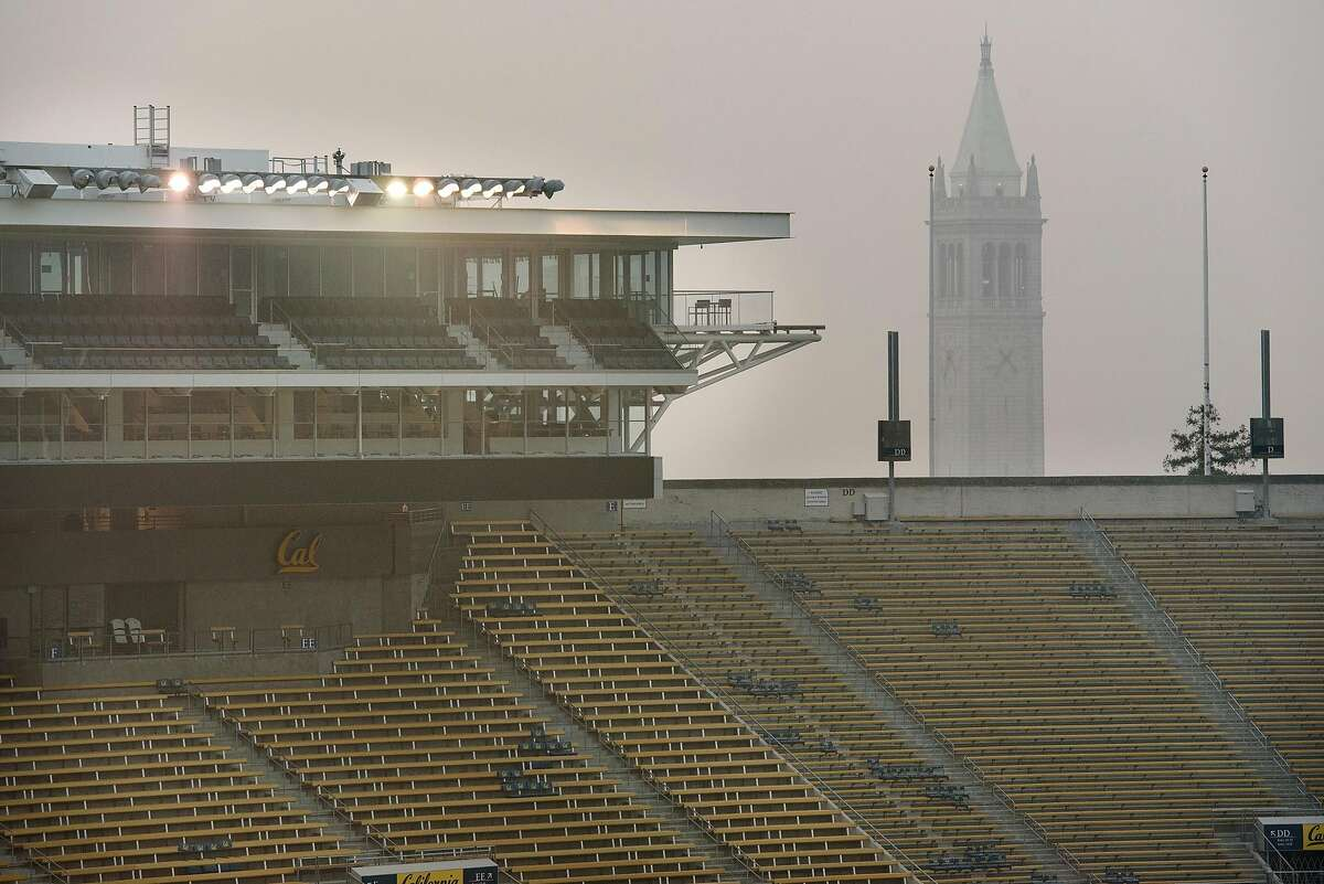 """A smokey haze hangs over Memorial Stadium and Sather Tower after it was announced that the """"Big Game"""" versus Stanford University over the weekend is canceled due to poor air quality, in Berkeley, California, on Friday, November 16, 2018."""