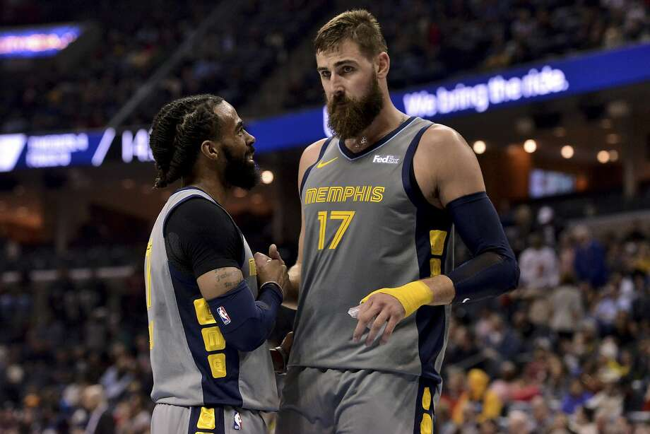 Mike Conley (left) and Jonas Valanciunas led the Grizzlies over the Houston Rockets in overtime. Photo: Brandon Dill / Associated Press