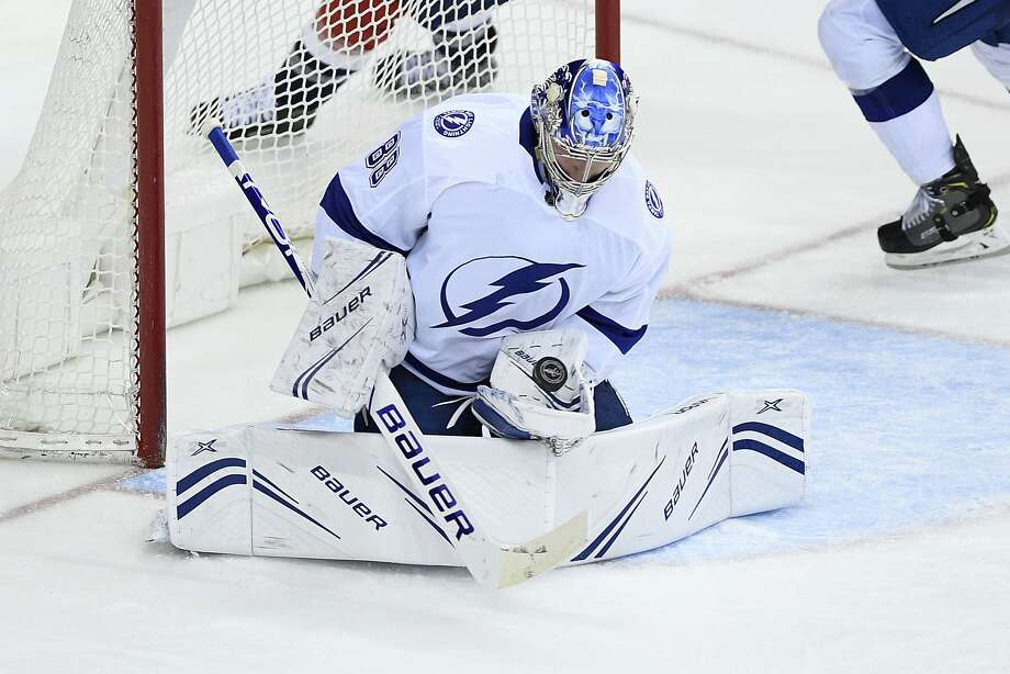 Lightning goaltender Andrei Vasilevskiy records one of his team-record 54 saves in Tampa Bay's win over the Capitals. Photo: Nick Wass / Associated Press