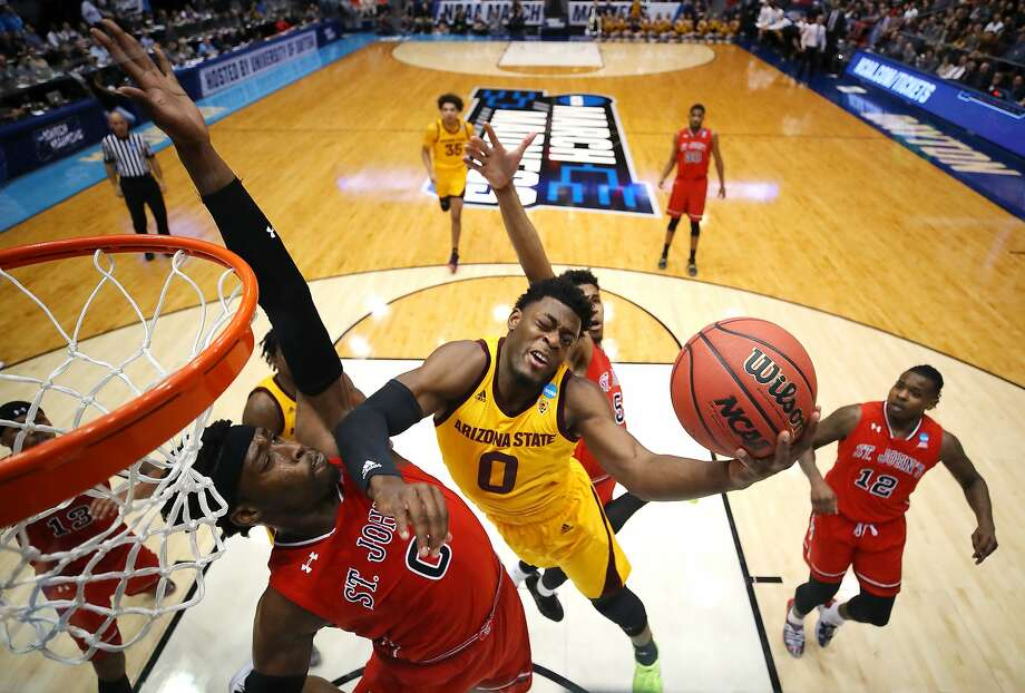 Arizona State's Luguentz Dort goes up for a shot as St. John's Sedee Keita defends in the first half of the NCAA tourney game. Photo: Gregory Shamus / Getty Images
