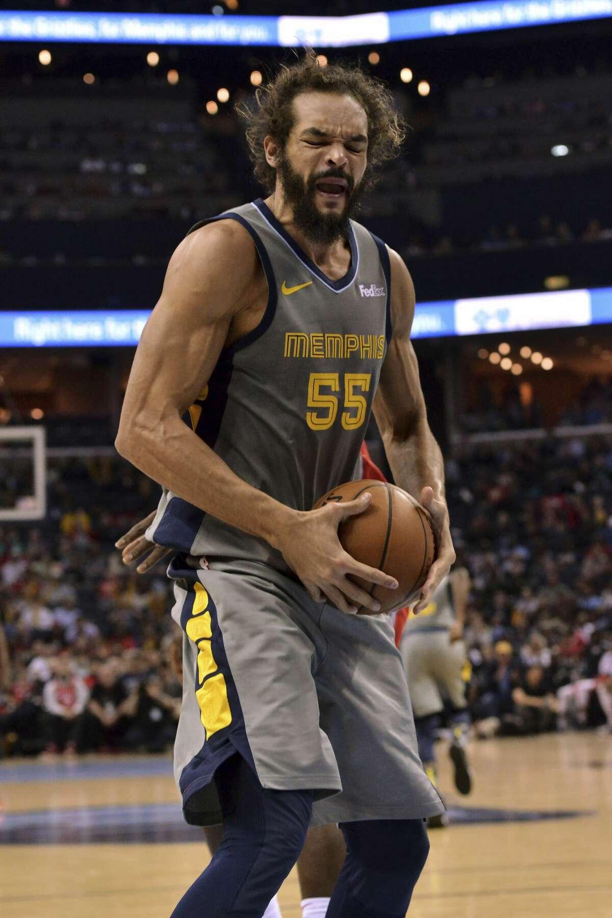 Memphis Grizzlies center Joakim Noah (55) grabs a loose ball in the second half of an NBA basketball game against the Houston Rockets Wednesday, March 20, 2019, in Memphis, Tenn. (AP Photo/Brandon Dill)
