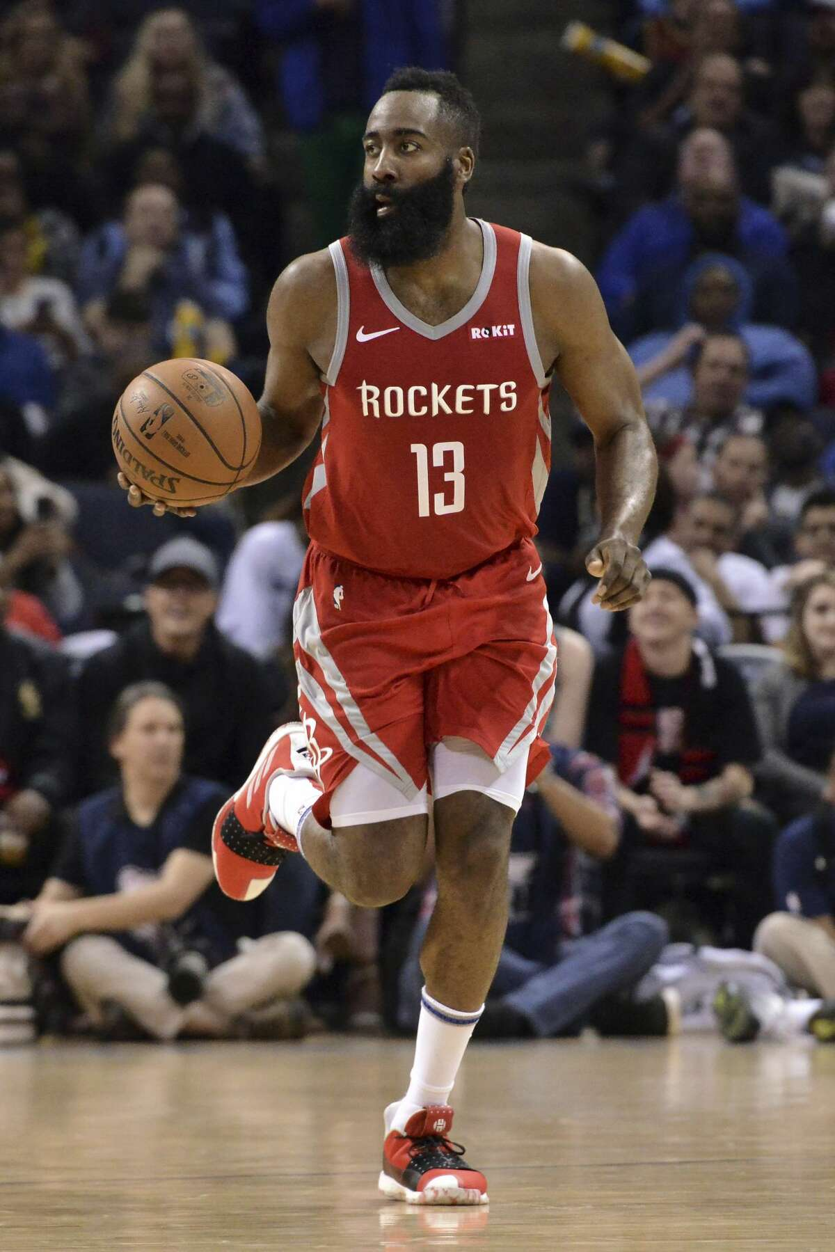 Houston Rockets guard James Harden (13) brings the ball up court in the second half of an NBA basketball game against the Memphis Grizzlies Wednesday, March 20, 2019, in Memphis, Tenn. (AP Photo/Brandon Dill)