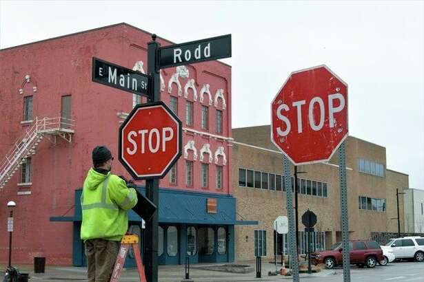 New stop signs replace the old, temporary signs in downtown Midland on March 15, 2019. (Ashley Schafer/ashley.schafer@hearstnp.com)