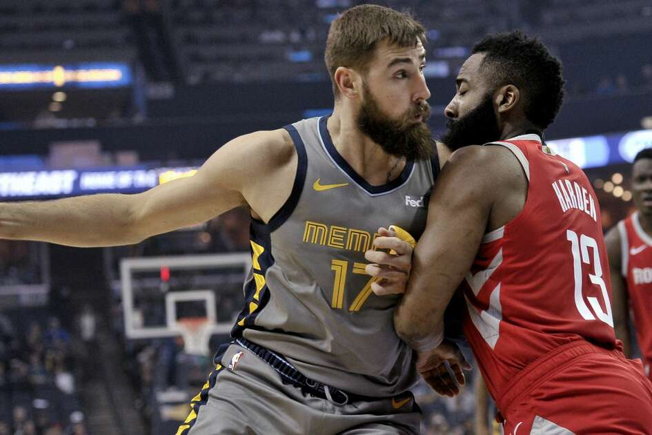 Memphis Grizzlies center Jonas Valanciunas (17) is defended by Houston Rockets guard James Harden (13) during the first half of an NBA basketball game Wednesday, March 20, 2019, in Memphis, Tenn. (AP Photo/Brandon Dill)