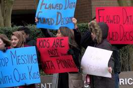 Parents and students from the Sugar Land-area development Riverstone protested against proposed middle-school re-zoning outside the Feb. 18 school board meeting.