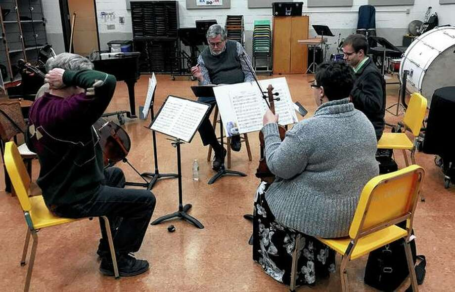 """Jacksonville Symphony Orchestra conductor and music director Garrett Allman (center) leads a chamber ensemble rehearsal ahead of the orchestra's """"Embrace the Music"""" concert on Saturday. The concert will focus on chamber music designed for small groupings of instruments. Photo: Photo Provided"""