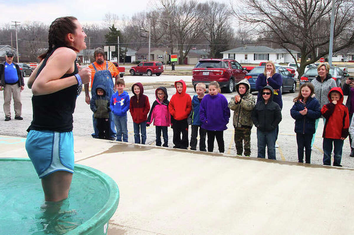 Elementary physical education teacher Victoria Miller's first-grade students watch her get ready to take the plunge Wednesday as part of an ice-water challenge at Meredosia-Chambersburg schools. Students and staff in the district donated $10 to participate. The event was organized by the student council and the Law Enforcement Torch Run to benefit Special Olympics. Go to myjournalcourier.com to see more photos from the event.