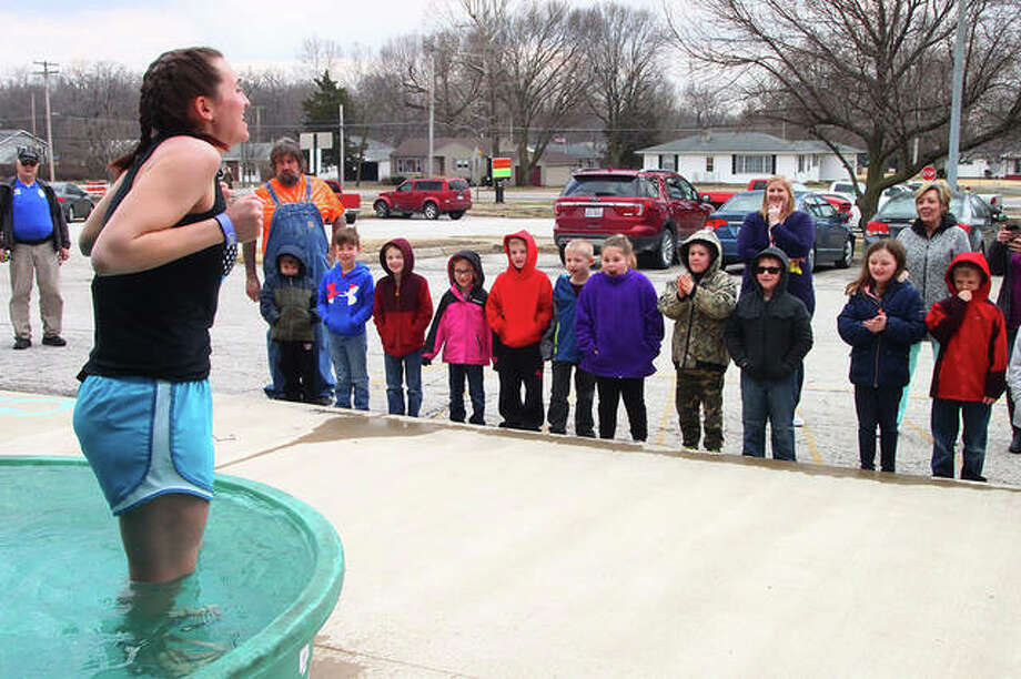 Elementary physical education teacher Victoria Miller's first-grade students watch her get ready to take the plunge Wednesday as part of an ice-water challenge at Meredosia-Chambersburg schools. Students and staff in the district donated $10 to participate. The event was organized by the student council and the Law Enforcement Torch Run to benefit Special Olympics. Go to myjournalcourier.com to see more photos from the event. Photo: Rosalind Essig | Journal-Courier