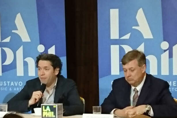 Gustavo Dudamel, left, and Simon Woods, chief executive officer of the Los Angeles Philharmonic, appear at a press conference in Tokyo on Wednesday.