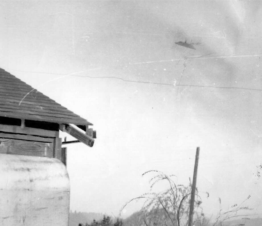 """Allen, Jan. 18 """"It zig-zagged across the sky in fluid and precise motions moving back behind houses and extremely close to the total five people around.""""  Photo: UNKNOWN/P-I FILE"""