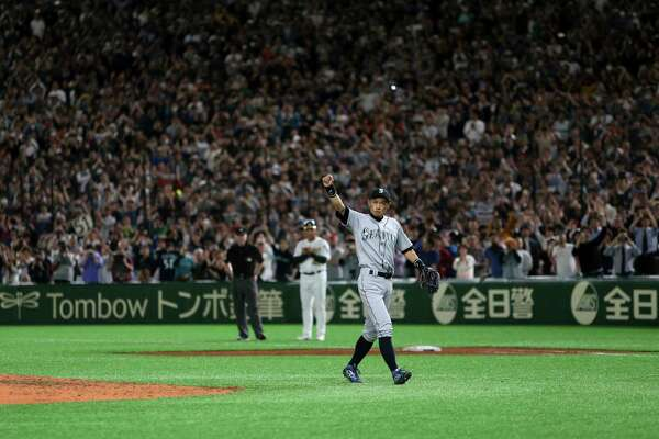 Seattle Mariners right fielder Ichiro Suzuki waves to spectators while leaving the field for defensive substitution in the eighth inning of Game 2 of the Major League baseball opening series against the Oakland Athletics at Tokyo Dome in Tokyo, Thursday, March 21, 2019.