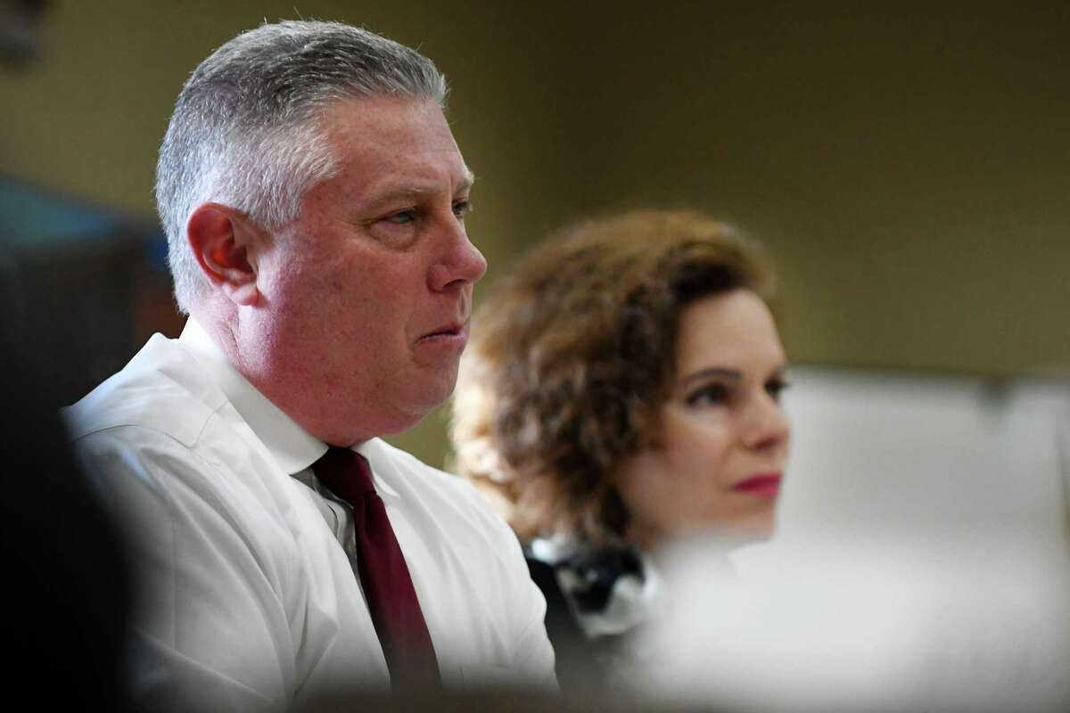 Assemblymember John T. McDonald III, left, and Assemblymember Patricia Fahy, right, listen to representatives from the Capital Region business community during a roundtable to discuss the potential impacts of marijuana legalization on Thursday morning, March 21, 2019, at the Capital Region Chamber in Colonie, N.Y. (Will Waldron/Times Union)