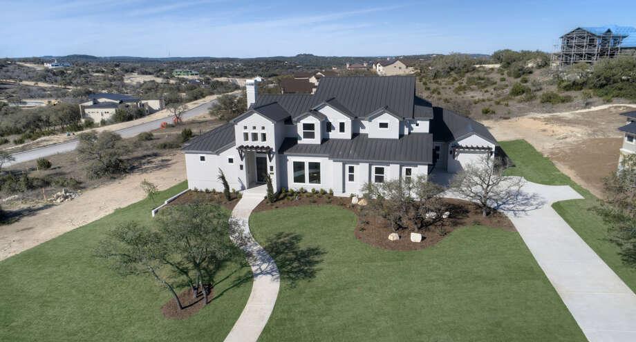 Builder: McNair Custom Homes Community: Canyons at Scenic Loop Address: 10211 Nina Ridge, SA TX 78255 Price: $985,000 Photo: McNair Custom Homes