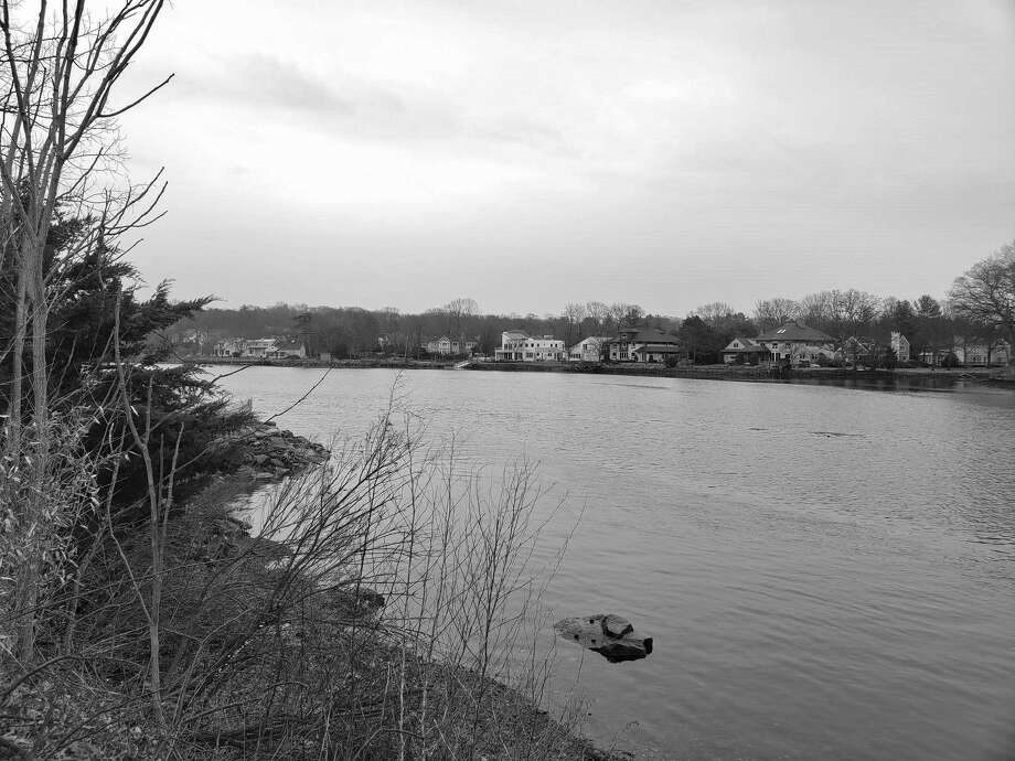 A cloudy view of the Saugatuck River from Riverside Avenue on March 21, 2019. Photo: Liana Teixeira / Hearst Connecticut Media
