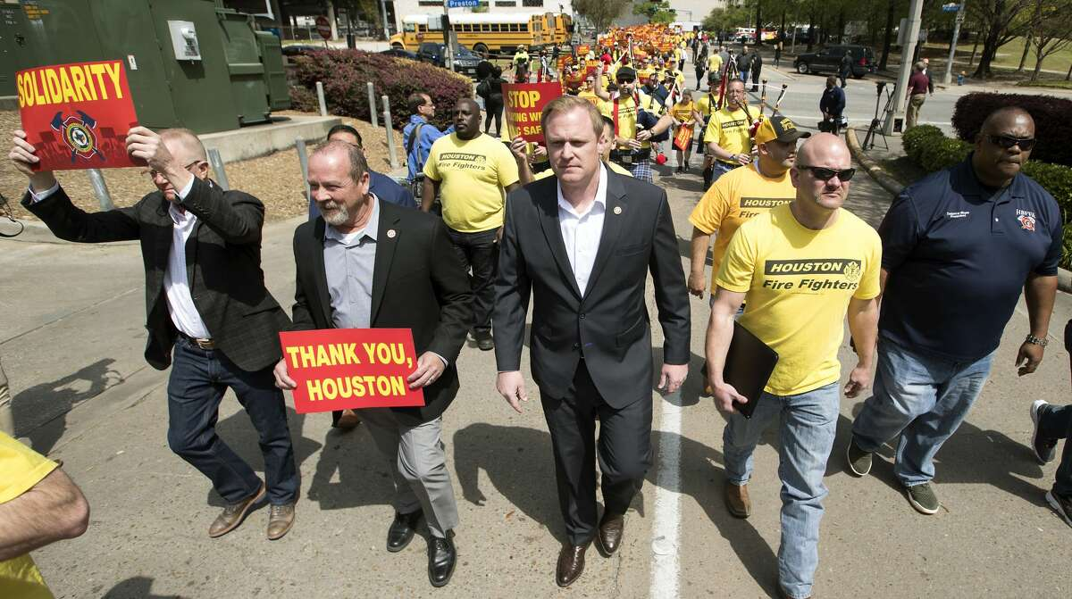 Marty Lancton, center, the head of the Houston Professional Fire Fighters Association, leads a march on City Hall over the labor dispute related to Proposition B on Tuesday, March 19, 2019, in Houston. Mayor Sylvester Turner recently told council members he intends to lay off up to 400 firefighters to fund the pay raises mandated by Prop. B.
