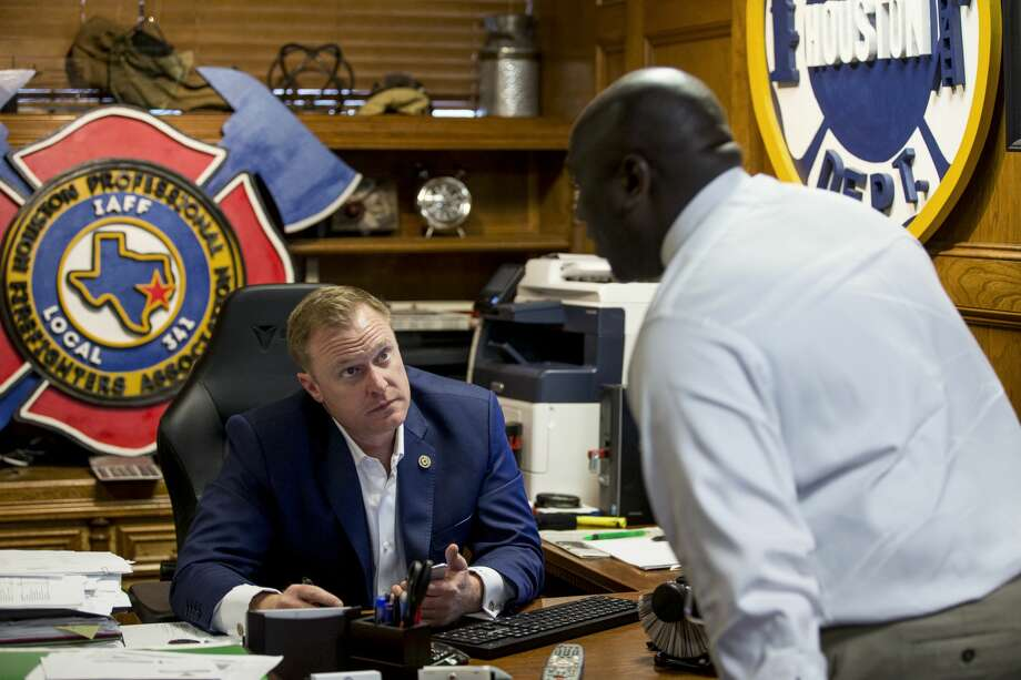 Marty Lancton, president of the Houston Professional Firefghters Association, talks to Roy Cormier as he works in his office the IAFF Local 341 union hall on Thursday, Feb. 7, 2019, in Houston. Lancton has been at the center of the fight with the city over pensions and pay. Photo: Brett Coomer/Staff Photographer