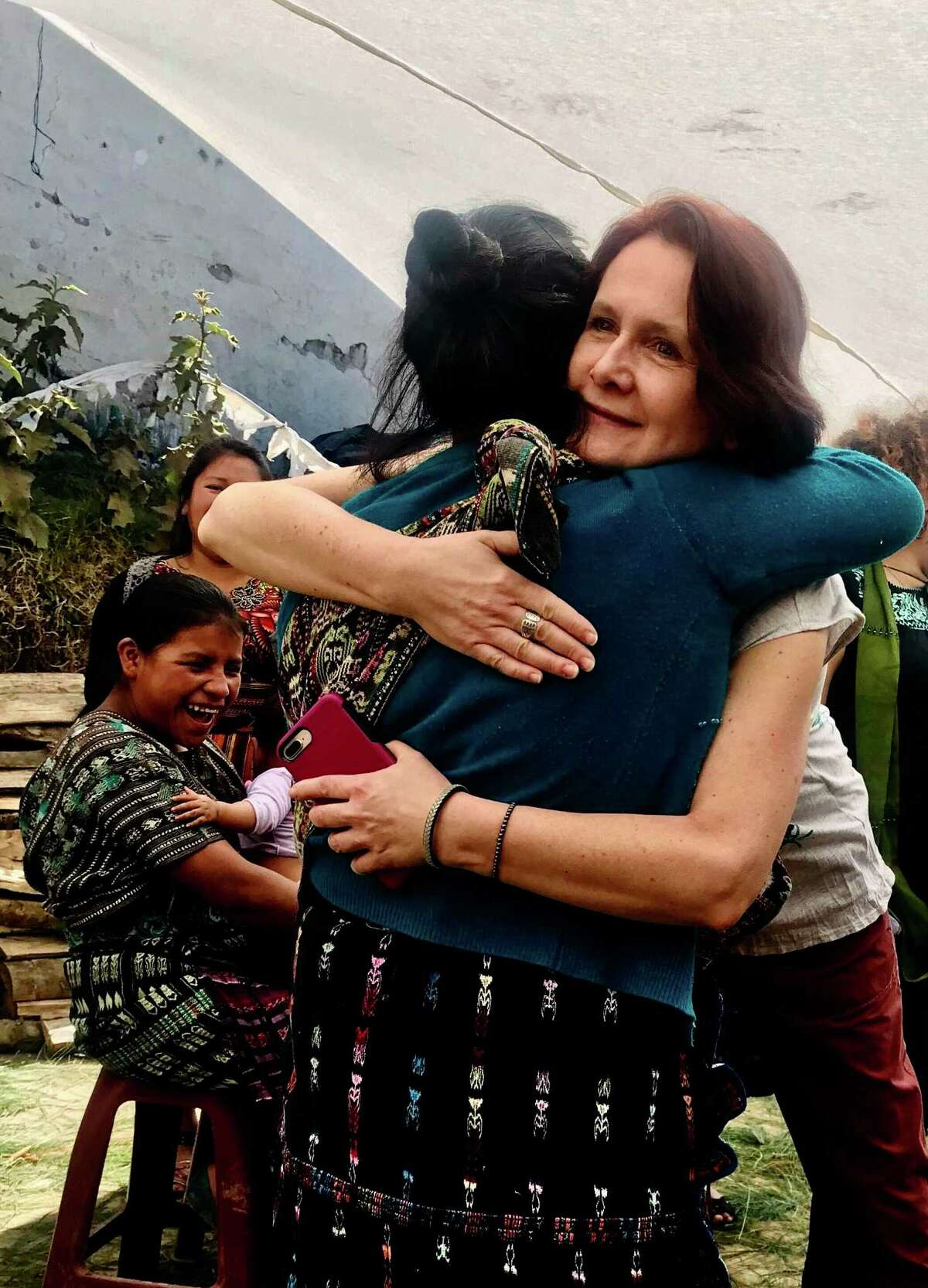 Siena College Professor Vera Eccarius-Kelly gives a hug to a young Mayan woman inLa Fe, Guatemala on a trip with student researchers fromFebruary 23-March 4, 2019. Kelly is on the board of Mayan Hands, an Albany-based non-profit organization economically empowering Mayan women in Guatemala.