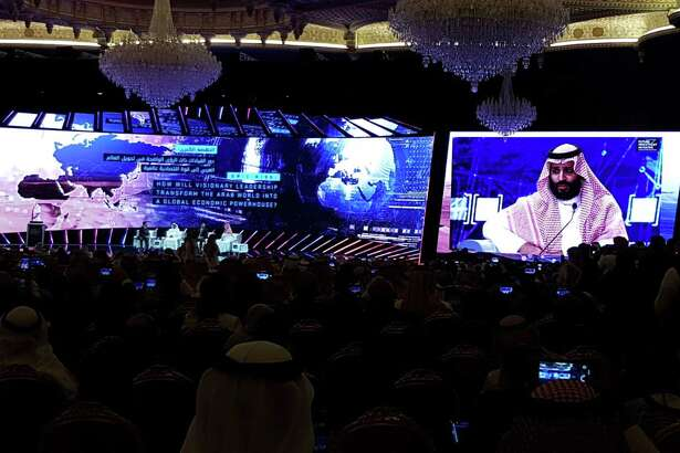 Saudi Crown Prince Mohammed bin Salman is displayed on a screen as he speaks at the Future Investment Initiative conference inside the King Abdulaziz Convention Center in Riyadh, Saudi Arabia, on Oct. 24, 2018.