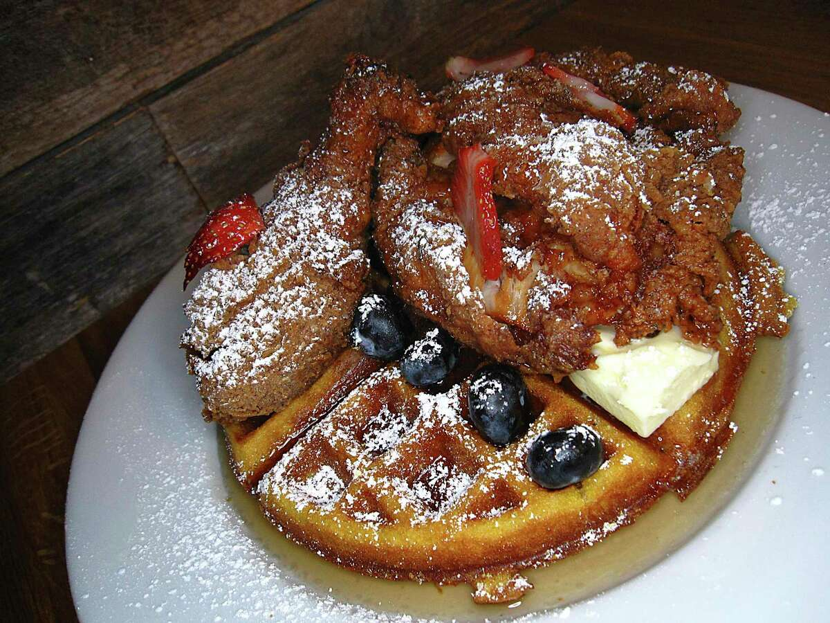 Eastside Kitchenette's brunch menu features Southern comfort food like fried chicken with a pumpkin waffle, berries and maple syrup.