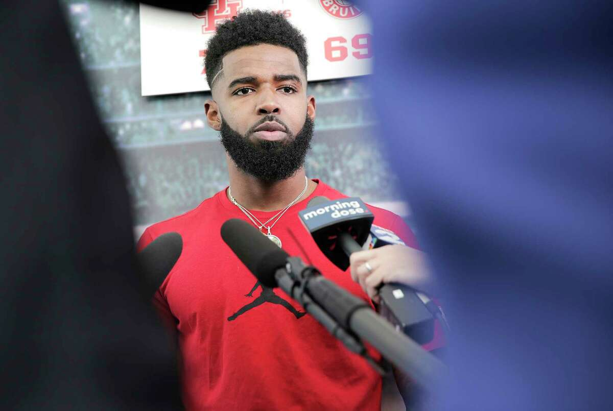UH guard Corey Davis talks to the media at the before loading onto a bus to leave for the NCAA tournament in Tulsa on Wednesday, March 20, 2019.