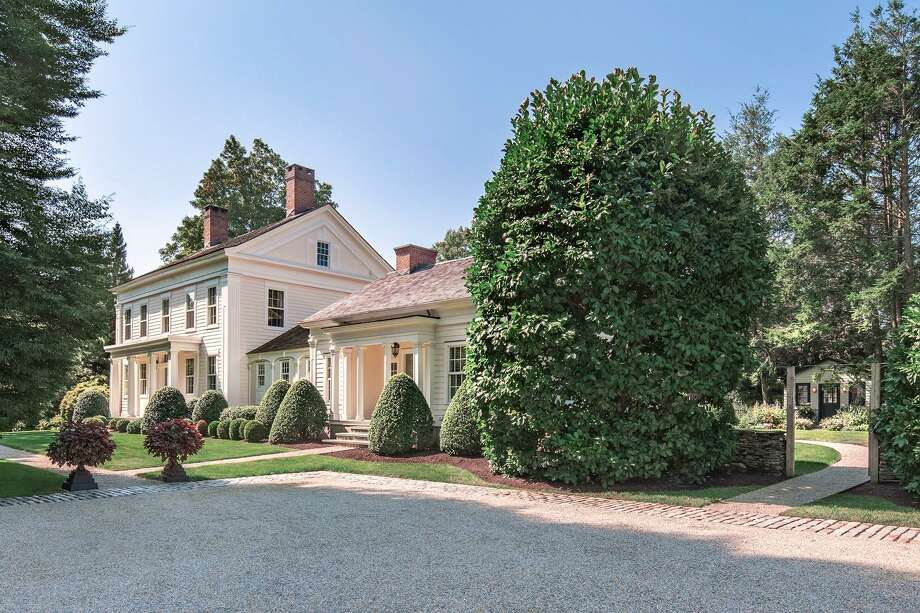 The 4,698-square-foot Greek Revival at 1555 Burr St. in Fairfield — which town records say was built in 1819 — had fallen into disrepair when it was purchased by its current owners. They vastly renovated not just the house, but the gardens and other landscaping. Today, the home, with links to the historic Burr family, is a breathtaking mix of classic architectural details and modern style. Photo: Contributed Photos / Connecticut Post Contributed