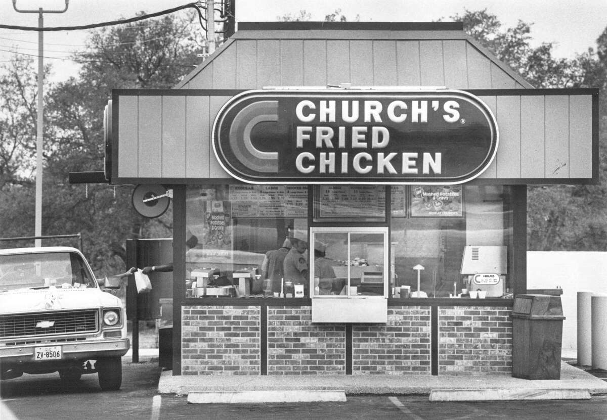 1. George W. Church Sr. opened the very first Church's Fried Chicken To-Go in Alamo Plaza in 1952. Shown is a Church's Fried Chicken in an undated Express-News file photo.