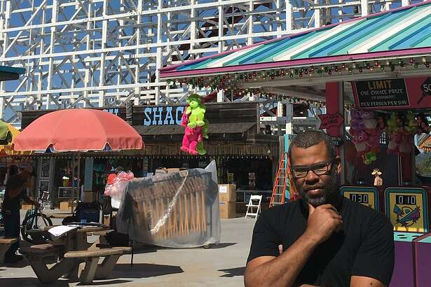 Director Jordan Peele stands before the Giant Dipper during the shoot for Us in September 2018. The crew built a set on the beach, and then spent a week shooting at the Boardwalk and the adjacent section of Main Beach.