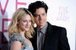 """Lili Reinhart, left, and Cole Sprouse arrive at the Los Angeles premiere of """"Five Feet Apart"""" on Thursday, March 7, 2019, in Los Angeles."""