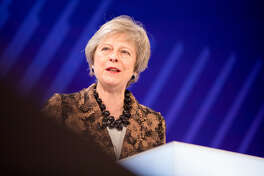 British Prime Minister Theresa May speaks at a conference in London on Nov. 19, 2018.