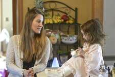Katharine Pileggi watches as her daughter Emma, 3, takes a holistic treatment for inflammation. Thursday, March 14, 2019, in Sherman, Conn.
