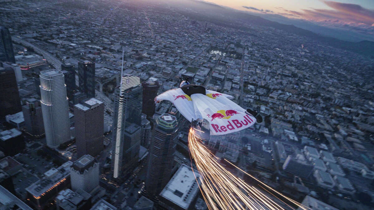 Red Bull skydivers sporting wingsuits fitted with LED lights created a spectacle in the sky over Los Angeles on Wednesday, March 20, 2019.