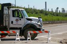 A City of Pasadena truck blocks the Pasadena Freeway Frontage Road as a shelter-in-place was issued Thursday, March 21, 2019, in Deer Park, Texas.