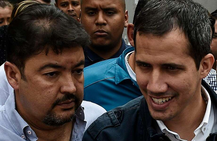 Opposition leader Juan Guaidó (right) stands by his aide, Roberto Marrero, who was detained in Caracas. Photo: Federico Parra / AFP / Getty Images