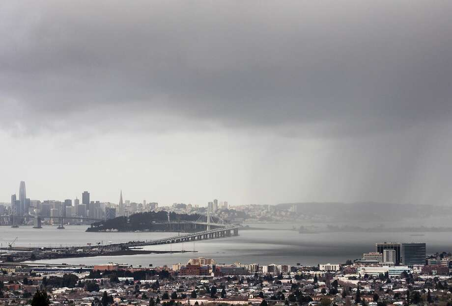 Rain can be seen falling over the Bay Area from Berkeley, Calif. Wednesday, Jan. 9, 2019. Photo: Jessica Christian, The Chronicle