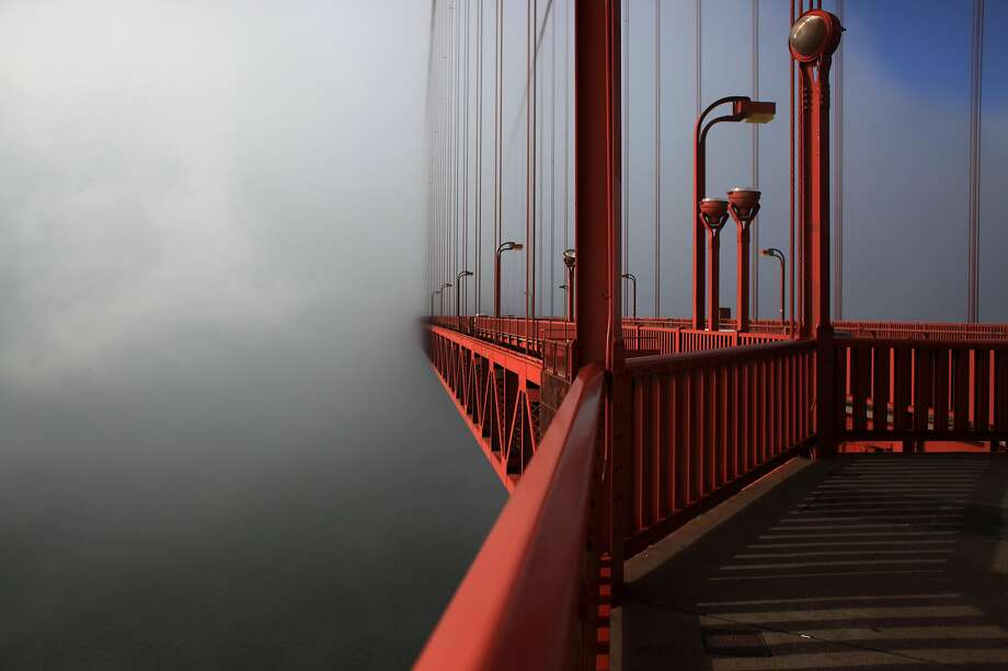 FILE -- A streamlined fog bank hides the south end of the Golden Gate Bridge on May 8, 2012 in San Francisco, Calif. Photo: Mike Kepka, The Chronicle