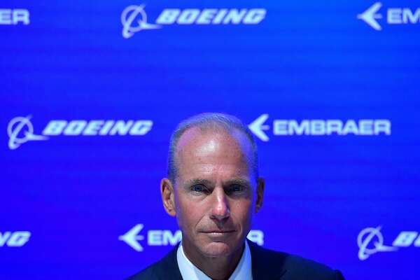 (FILES) In this file photo taken on July 16, 2018 Boeing CEO, Dennis Muilenburg gestures during an event at the Farnborough Airshow, south west of London. - Boeing CEO Dennis Muilenburg sought March 18, 2019, to reassure clients and passengers of the firm's commitment to safety in a video message published amid intense scrutiny following the Ethiopian Airlines Flight ET302 crash. The accident involving an Ethiopian Airlines Boeing 737 MAX 8 killed 157 people -- less than six months after a Lion Air jet of the same type crashed, killing 189 people. (Photo by Ben STANSALL / AFP)BEN STANSALL/AFP/Getty Images