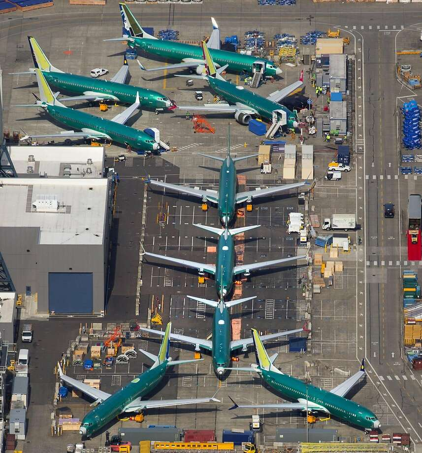 Several Boeing 737s are parked next to the factory across from Washington's Renton Municipal Airport. Photo: Mike Siegel / Seattle Times
