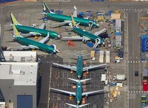 Boeing 737's, many of which are MAX 8 and 9's in various stages of completion, are parked next to the 737 factory across the runway from the Renton Municipal Airport on March 15, 2019. (Mike Siegel/The Seattle Times/TNS)