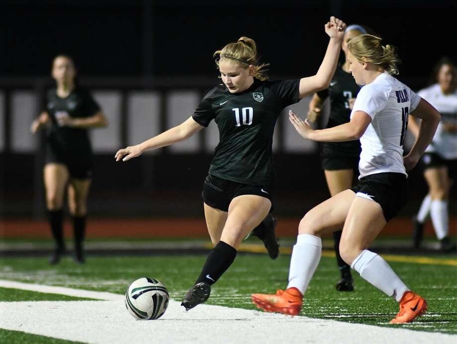 Kingwood Park senior midfielder Taylor DeBrosky (10) playsthe ball against Willis junior defender Ryanne Janowski (18) during the first period of their District 20-5A matchup at KPHS on March 20, 2019. Photo: Jerry Baker, Houston Chronicle / Contributor / Houston Chronicle