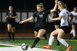 Kingwood Park senior midfielder Taylor DeBrosky (10) playsthe ball against Willis junior defender Ryanne Janowski (18) during the first period of their District 20-5A matchup at KPHS on March 20, 2019.